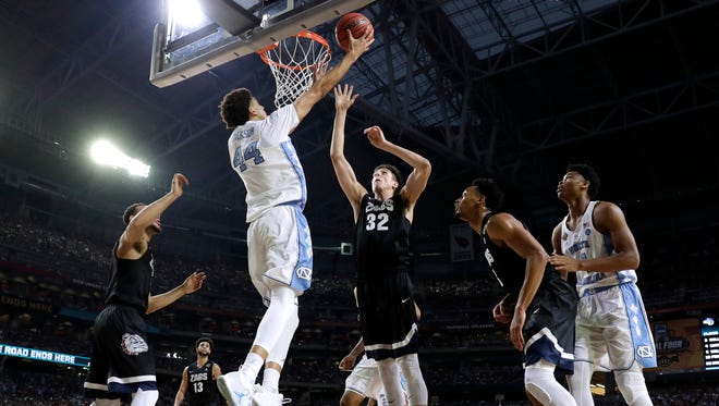 North Carolina forward Justin Jackson (44) shoots over Gonzaga forward Zach Collins (32) during the first half in the NCAA college basketball championship game April 3. Don't hold your breath waiting for a bill that would pull UNC out of the Atlantic Coast Conference to pass the state General Assembly.
