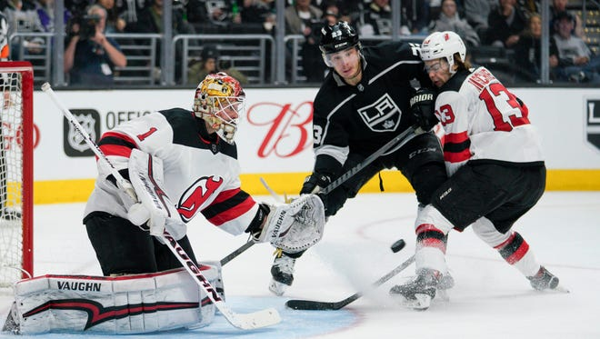 New Jersey Devils goalie Keith Kinkaid (1) makes a save against the Los Angeles Kings during the second period at Staples Center.
