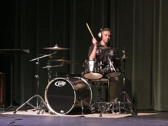"""Dylan Larson performs a Drum Solo """"Diamond Eyes"""" at the Groove Kids show inside the Heritage Center Theater on Monday."""