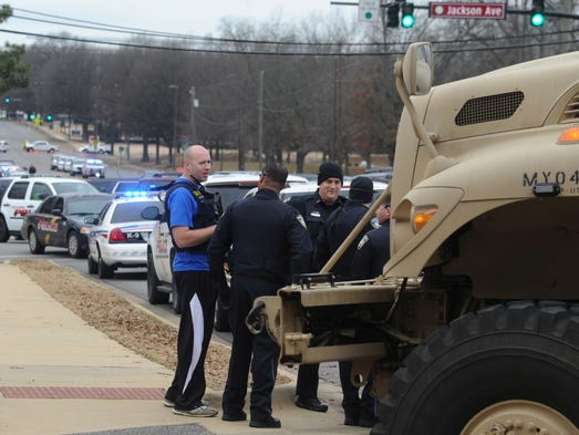 Law enforcement respond to the Alabama Credit Union