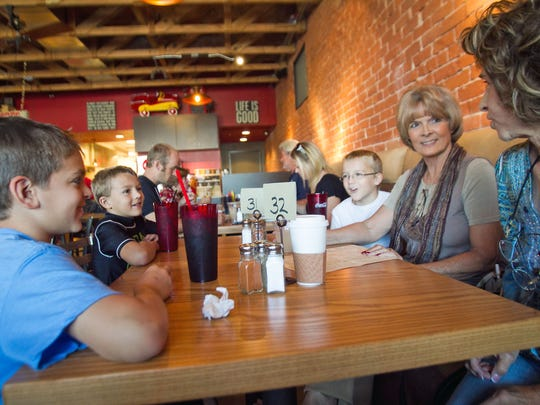 A group of family and friends eat at Cafe 25:35 in Buckeye.