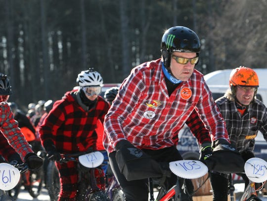 Racers got extra points for wearing flannel in the wintry Hugh Jass fat bike race at Kettle Moraine State Forest.