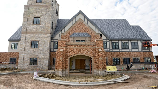 The main entrance and front of the Sanford Foundation House. The building, which is located in the Sanford Center corporate campus, is slated to be completed in November and will focus on philanthropist T. Denny Sanford, whose donations to the Sioux Falls-based health system total almost $1 billion.