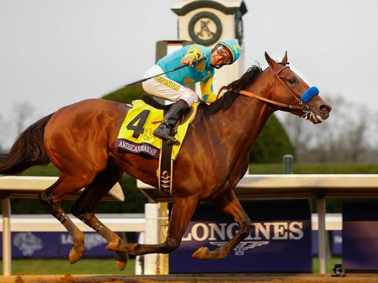 American Pharoah and Victor Espinoza win the Breeders' Classic and set a track record for the distance. 