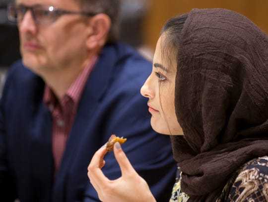 Hera Ashraf, of Carmel, Indiana, eats a date as she breaks her daily fast during an interfaith service observing iftar during Ramadan on June 21, 2017.