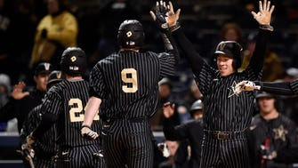 Vanderbilt's Jeren Kendall (3, right) and Reed Hayes (24,left) celebrate with Will Toffey (9) after scoring on Toffey's in-the-park home run during the fourth inning against Belmont at First Tennessee Park in Nashville, Tenn., Wednesday, March 22, 2017.