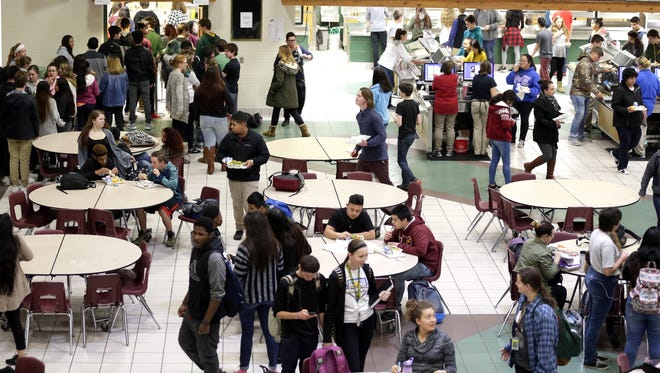 Students line up for lunch at Green Bay Preble High School, which has experienced crowding issues.