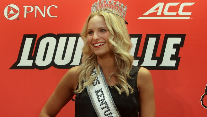 University of Louisville volleyball player and newly-crowned Miss Kentucky Katie George meets with reporters on Monday afternoon.January 12, 2015