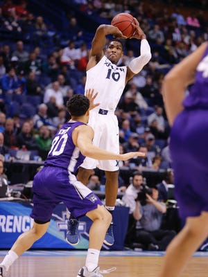 Xavier's Remy Abell shoots and makes a 3-pointer in the first half against Weber St.
