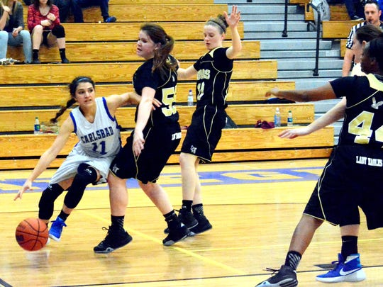 Cavegirls senior guard Kloey Tiller looks to pass the ball in the third quarter Friday.