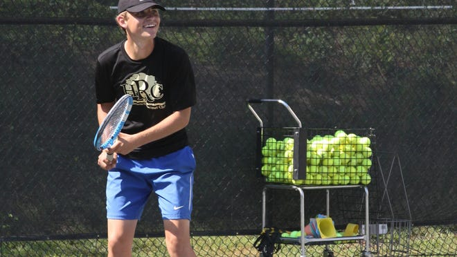 Hendersonville Racquet Club Adult Programs Manager Cre Still smiles during one of his classes recently. Still won the Banana Open title last week in Asheville.