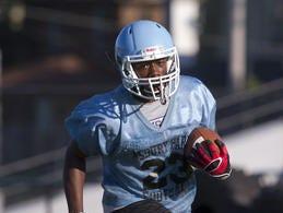 Asbury Park's Charles Sanders scored the winning touchdown against Metuchen on Saturday.