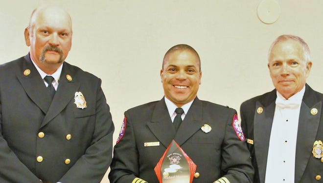 Michael Morrow, Captain with the Ruidoso Fire Department, holds his Fire Officer of the Year award at the annual the New Mexico Fire and Emergency Medical Services Expo. From left are Deputy State Fire Marshall Brad Brunson, Morrow and New Mexico State Fire Marshal John Standefer.