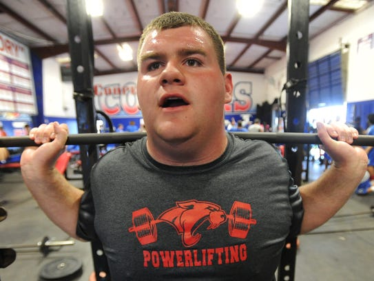 Cooper junior Johnathan Presley lifts during powerlifting