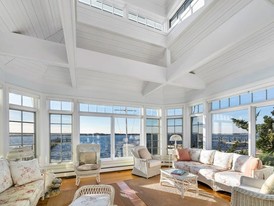 This home offers a two-story solarium adjacent the kitchen.