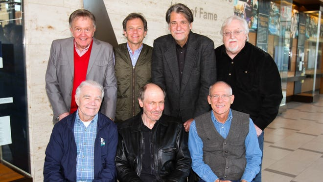 Nashville Songwriters Hall of Fame members pose for a photo in front of their new gallery. Standing: Bill Anderson, Tom Douglas, Richard Leigh and Pat Alger. Seated: Dickey Lee, Bobby Braddock and Allen Shamblin.
