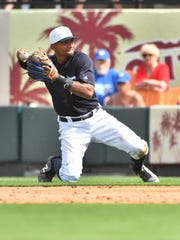 Tigers second baseman Dixon Machado makes a throw from