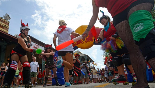 """People participate during the annual """"Fiesta de San Fermin en Pensacola"""" Running of the Bulls. The Fiesta returns starting Thursday, with the Running of the Bulls taking place Saturday."""