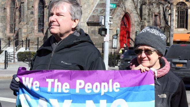 Local residents gathered Monday to rally at Renaissance Plaza in White Plains.