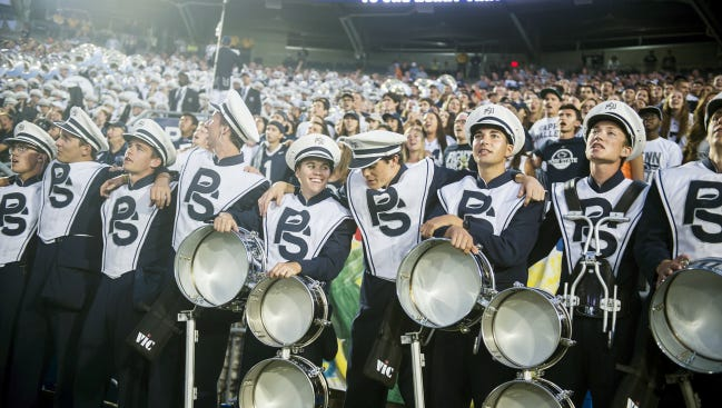 Members of the Penn State Blue Band participate in the singing of the Alma Mater after Penn State's football game against San Diego State on Sept. 26 at Beaver Stadium.