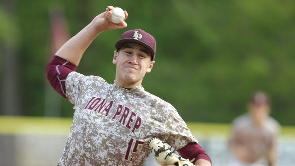 Iona Prep pitcher Samuel Bello (15) delivers a pitch