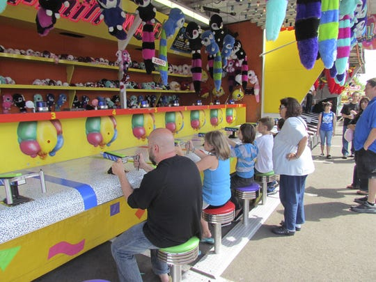 Gunning for carnival prizes: activities at Keizer Station during the Iris Festival Saturday, May 19, 2012.