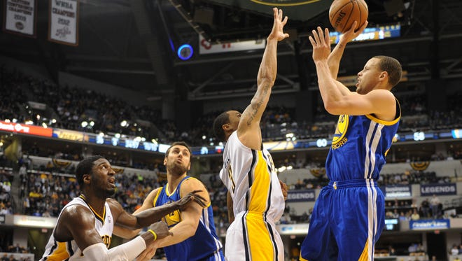 In a game on March 4, 2014, Indiana's Roy Hibbert and George Hill tried to defend against Golden State's Stephen Curry.