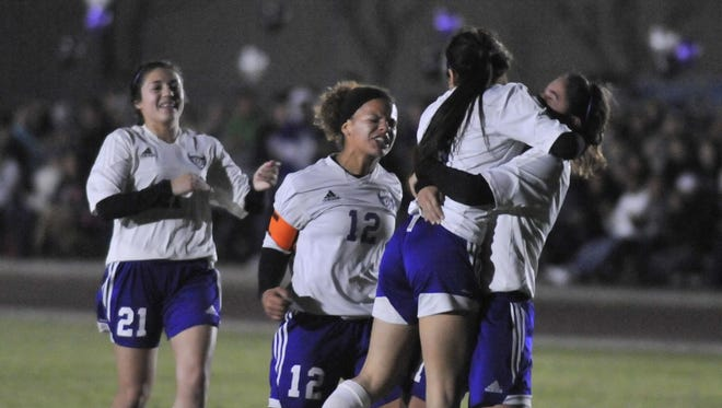 Mission Oak celebrates after taking the first goal against Liberty in a Central Section Division III girls soccer championship game on February 24, 2017.