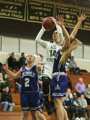 Rice's Lisa Sulejmani (14) leaps for a lay up during the girls basketball game between Brattleboro and Rice on Tuesday night.