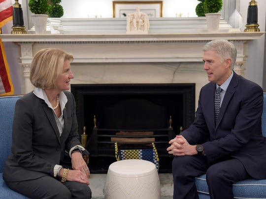 Supreme Court nominee Judge Neil Gorsuch, right, meets