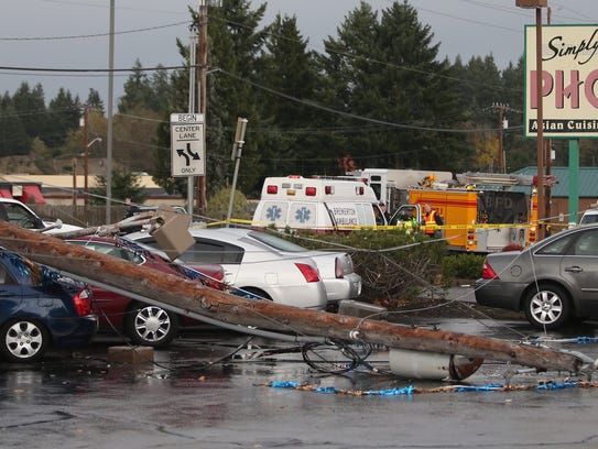A ran into a power pole, knocking down several other power poles on Wheaton Way in Bremerton on Monday morning.