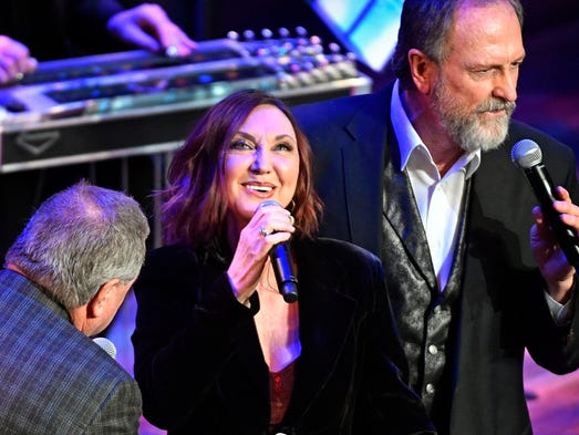 Steve and Rudy Gatlin perform with Pam Tillis at the
