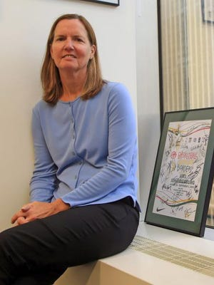 Kathy Behrens of Irvington, the NBA's executive vice president of social responsibility & player programs, poses in her office in Manhattan last week. Behrens will be inducted into the Westchester Sports Hall of Fame on Wednesday.