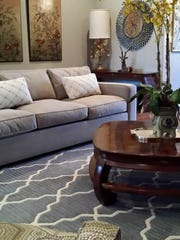 Remodeled living area complete with art, furnishings and coffee table.
