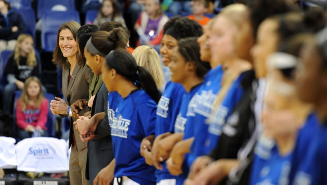 Tuscola graduate Brenda Mock Kirkpatrick, far left, coaches the UNC Asheville women's basketball team.