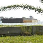 A barge has run aground near Little Sabine Bay on Thursday, June 16, 2016.
