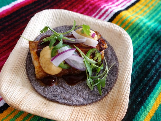 Grilled pork belly taco with roasted pineapple, shaved red onion, jalapeño and cilantro from Crujiente Tacos at the 2017 azcentral.com Food & Wine Experience.