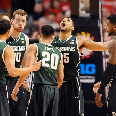 MSU's Bryn Forbes, Matt Costello, Travis Trice, Denzel Valentine, and Branden Dawson, left to right, gather at the end of MSU's 80-69 overtime loss against Wisconsin in the Big Ten Tournament Championship game in Chicago.