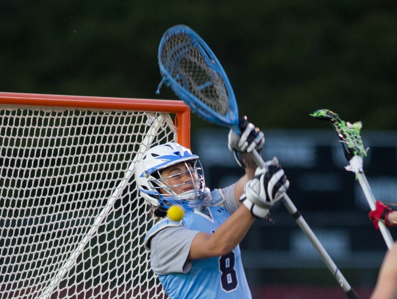 Cape Henlopen's goalie Iseabal Cryne (8) tries to block a shot by Polytech in the second half of play.