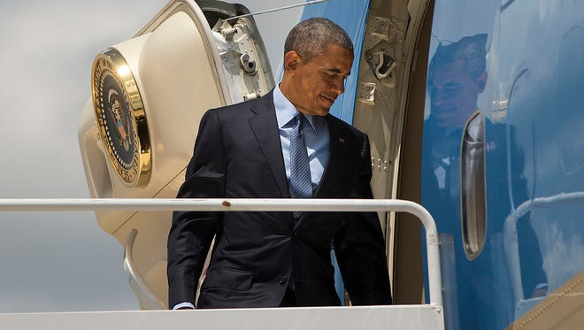 President Obama boards Air Force One before his departure from Andrews Air Force Base, Wednesday, May 27, 2015, en route to Miami.