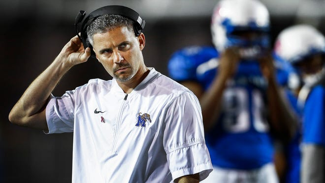 Dejected University of Memphis head coach Mike Norvell looks to the scoreboard as the Tigers fall 59-30 to the University of Tulsa at the Liberty Bowl Memorial Stadium.