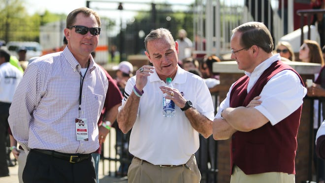 MSU president Mark Keenum (right) MSU women's basketball coach Vic Schaefer (center) and MSU athletic director John Cohen talk on the sideline. Mississippi State conducted its Maroon & White Spring Game for football on Saturday, April 8, 2017. Photo by Keith Warren