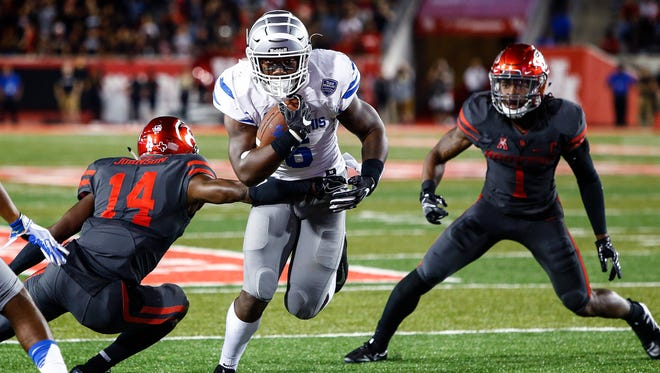 University of Memphis running back Patrick Taylor Jr. (right) scores a touchdown against the University of Houston defense during third quarter action in Houston, Texas., Thursday, October 19, 2017.