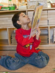 """Southwest Human Development distributes more than 100,000 children's books to families through its """"Raising a Reader"""" and """"Reach Out and Read"""" programs."""