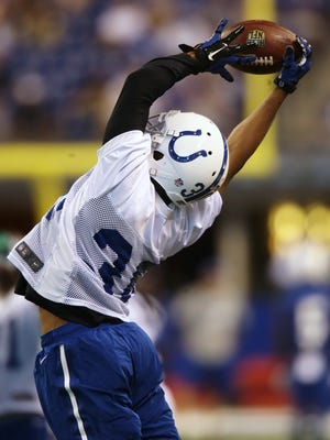 Unsigned draft cornerback D'Joun Smith (30) leaps to receive a pass during public practice at the annual Indianapolis Colts mini-camp and fan open house at Lucas Oil Stadium in Indianapolis, Ind., Wednesday, June 10, 2015.