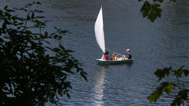 A small sailboat takes to the water on Tuesday, July 28, 2015, at Riverfront Park in Salem, Ore. A heat advisory has been put into effect beginning Wednesday until 9 p.m. Friday, according to the National Weather Service.
