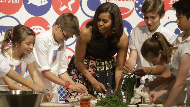 U.S. first lady Michelle Obama participates in a cooking demonstration at the James Beard American Restaurant with Italian and American middle school students in Milan, Italy, Wednesday, June 17, 2015.