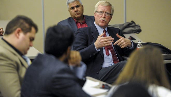 Dr. James Henderson, provost and vice president for academic affairs at the University of Louisiana at Lafayette, addresses students regarding the relocation of the Center for Advanced Computer Studies facilities during a town hall meeting at Moody Hall in Lafayette in 2014.