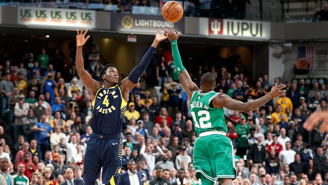 Boston Celtics guard Terry Rozier (12) steals a pass intended for Indiana Pacers Victor Oladipo (4) and scores the game-winning basket in the finals seconds of their game at Bankers Life Fieldhouse Monday, December 18, 2017. The Boston Celtics defeated the Indiana Pacers 112-111.