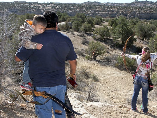 Nate Castillo, 4, and his grandfather, Ben Castillo, wait for their turn during the Chokecherry 3D Shoot on Saturday at the San Juan Archers range in Farmington.